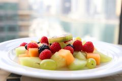 Fruit berries salad on a white plate Stock Photos