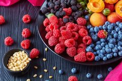 Fruit and berries saladon a plate royalty free stock images