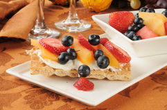 Fruit and berries on sesame crispbread Stock Photos