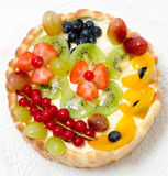 Fruit and berry cake. A fresh fruit and berry cake - a top view royalty free stock image