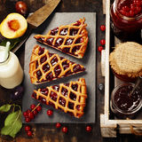 Fruit and berry jam and pieces of fruit tart Royalty Free Stock Image
