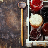 Fruit and berry jam on a rustic background Royalty Free Stock Images