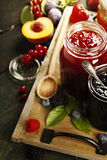 Fruit and berry jam on a wooden background Stock Images