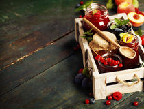 Fruit and berry jam on a wooden background Royalty Free Stock Photo