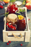 Fruit and berry jam on a wooden background Royalty Free Stock Images