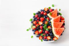 Fruit and berry platter over white. blueberry, strawberry, raspberry, blackberry, watermelon stock photos