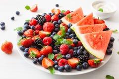 Fruit and berry platter over white. blueberry, strawberry, raspberry, blackberry, watermelon stock image