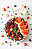 Fruit and berry platter over white. blueberry, strawberry, raspberry, blackberry, watermelon royalty free stock images