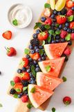 Fruit and berry platter over white. blueberry, strawberry, raspberry, blackberry, watermelon royalty free stock photography