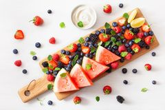 Fruit and berry platter over white. blueberry, strawberry, raspberry, blackberry, watermelon stock images