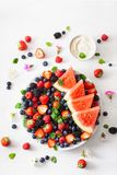 Fruit and berry platter over white. blueberry, strawberry, raspberry, blackberry, watermelon royalty free stock image
