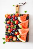Fruit and berry platter over white. blueberry, strawberry, raspberry, blackberry, watermelon royalty free stock photos