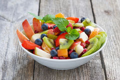 Fruit and berry salad on wooden table Royalty Free Stock Photo