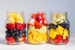 Fruit and Berry Salads in Jars. Homemade Fruit and Berry Salads in Jars, Great Idea for Take Away Healthy Snack. Clean or Detox Eating Concept Royalty Free Stock Images