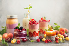 Fruit berry smoothie. Clean eating ideas for breakfast or snack. Assortment of  berry fruit  smoothies, juices and chia seeds pudding . Concept of healthy eating Stock Image