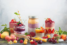 Fruit berry smoothie. Clean eating ideas for breakfast or snack. Assortment of  berry fruit  smoothies, juices and chia seeds pudding. Concept of healthy eating Royalty Free Stock Photography