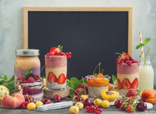 Fruit berry smoothie. Clean eating ideas for breakfast or snack. Assortment of  berry fruit  smoothies, juices and chia seeds pudding in front of a chalkboard Stock Images