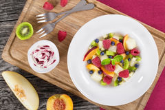 Fruit  and berry summer dessert salad decorated with mint Royalty Free Stock Photos
