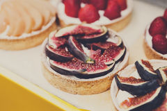 Fruit and berry tarts dessert tray assorted outdoors Royalty Free Stock Photo