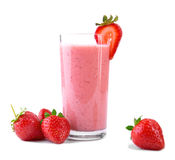 Fruit beverage with strawberries and milk. A glass full of fresh and bright red strawberries and organic milk. Pink smoothie . Stock Photo