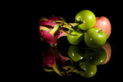 Fruit on black background. Green, red apples and dragon fruit on black background Royalty Free Stock Image