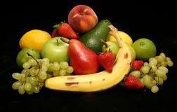 Fruit on black satin background Royalty Free Stock Photo