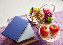 Fruit with blank books Stock Photos