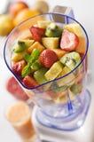 Fruit in blender. Mixed fruit in blender close up shoot royalty free stock photos