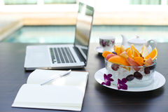 Fruit blow and laptop business computer Royalty Free Stock Photography