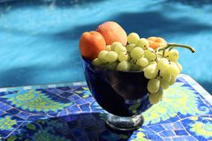 Fruit In A Blue Glass Bowl Royalty Free Stock Image
