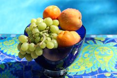 Fruit In Blue Glass Bowl stock photography