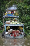 Fruit boat in Mekong river delta Stock Photo