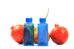 Fruit body scrub bottles. With real fruits against white background Royalty Free Stock Photos