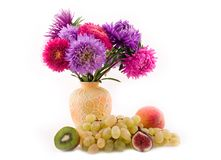 Fruit and bouquet. Of colors on a white background Stock Images