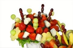 Fruit bouquet closeup. Assorted colorful fruits arranged into a decorative bouquet Stock Photos