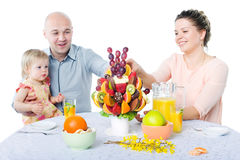 Fruit bouquet decoration on the dining table in front of happy f Stock Images