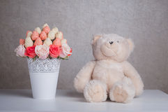 Fruit bouquet decoration with teddy bear toy on the table Stock Photo
