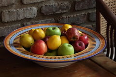 Fruit bowl. A bowl containing mix fruit on house setting Royalty Free Stock Image