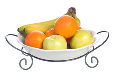 Fruit Bowl. A platter of fruit consisting of oranges, bananas and apples, isolated against a white background Royalty Free Stock Images