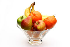 Fruit bowl. Crystal bowl of fruit on a white background Stock Images