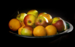 Fruit bowl. With apples and oranges Stock Photos