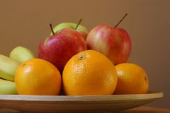 Fruit Bowl. Apples,bananas and oranges in a bowl Stock Photos