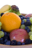 Fruit Bowl 3. A bowl of fresh fruit. Focus primarily on berries, front apple and grapes stock photography