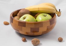 Fruit bowl. With exotic fruits and nuts Royalty Free Stock Photography
