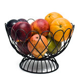 Fruit Bowl. On a white background containing oranges, plums, nectarines, pears, and mangos Stock Photography