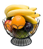 Fruit Bowl. On a white background containing oranges, nectarines, plums, oranges, mangos, and bananas Royalty Free Stock Photos