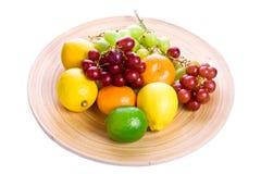 Fruit bowl. Large bowl of assorted fruit against white background Royalty Free Stock Photo