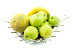 Fruit bowl with bananas, apples and melon Stock Photos