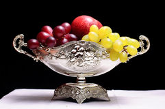 Fruit bowl. With flowers decoration Stock Images