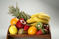 Fruit bowl with fresh fruits. A wood made fruit bowl with fresh fruits Royalty Free Stock Photo